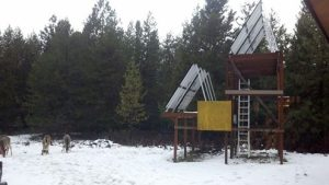 Solar panels set at a steep pitch for winter sun, and to shed snow.  The square board to the left of the ladder is where we hand the regulation dart board in the summer months.