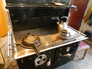 Griswold Puritan Waffle Iron, on a Kitchen Queen wood cook stove.
