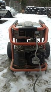 Rigid 6,800 watt generator.  Out in the cold and doing its job like a champ.