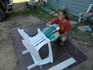 Krista priming the chairs. The chairs needed two coats of primer.