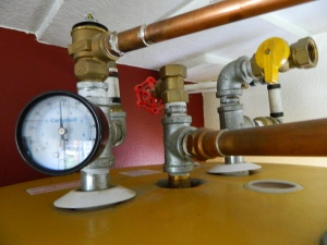 No pressure... but if this is not hooked up correctly it could be explosive. The T&P valve is after the pressure gauge that helps monitor the system. The temperature/pressure valve will open if water heats up to 150 degrees and release about 2 gallons of hot water out the drain pipe to a lidded 5 gallon bucket below. In the 2 years we have heated our water with this system our T&P valve has never opened because the water temperature has never risen above 123 degrees.