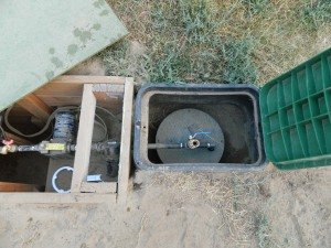 Another project checked off... The box and pipe is buried.  On the left id the pump, on the right is a hose fitting to prime the pump after it drains the secondary cistern.  The orchard is pleased with this new arrangement.