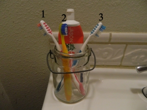 Three Tooth Brushes