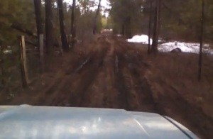 Mud bogging just to get home... Once mud season hits during spring breakup, we either shuttle back and forth in our 4x4 Suburban or hike it once the ruts get too deep.