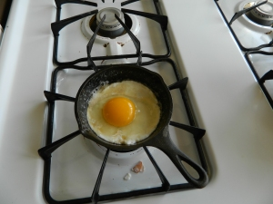 How to fry a farm fresh egg... Heat pan, remove egg's protective packaging, place egg yoke and white into pan, wait.