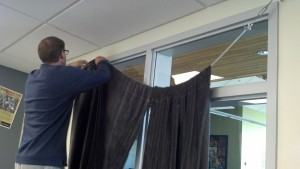 Drop the curtains... I accidentally dropped the currents twice while setting them in place. The curtains were donated by the art teacher while I purchased the hardware.
