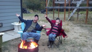 Silly boys... We decided to do a goofy pose for mom. This is our sky's the limit pose. The fire pit was made by a friend of ours who gave it to us as a gift. If you can tell, the fire pit is the bottom fourth of an old pressure tank to regulate domestic water pressure.