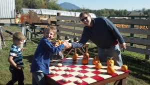 Setting up the game... Playing checkers with pumpkins was fun. We never figured out how to crown the kings.
