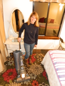 She approves... My wife poses with our new/used vacuum. She is smiling because I have already vacuumed the entire house